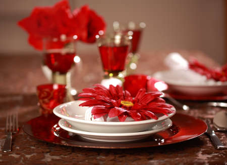 christmas catering: Luxury place setting in red and white  for Christmas or other event