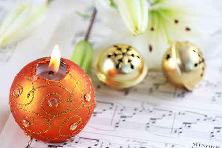 Christmas still life with jingle bells and music notes photo
