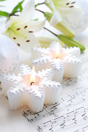 Christmas still life with candles and music notes photo