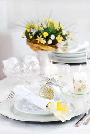 Luxury place setting in white  for Christmas or other event photo