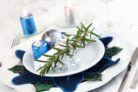 Place setting in white with rosemary for Christmas Stock Photo - 8036337
