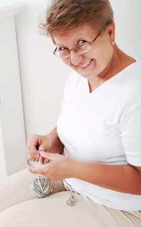 Photo of elderly woman knitting  photo