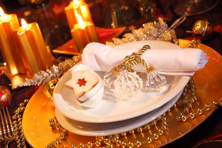 Luxury place setting in golden and white  for Christmas Stock Photo - 8184770