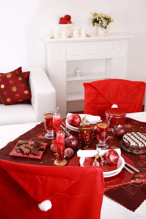 Place setting for Christmas in red and white tone photo