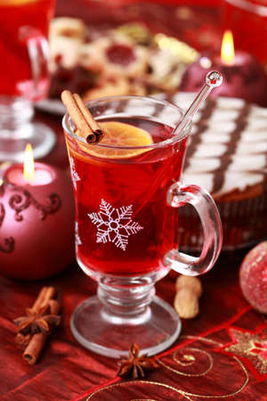 Hot wine punch for winter and Christmas with delicious cookies and marchpane cake photo