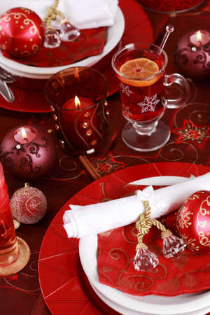 Place setting for Christmas with hot wine punch photo