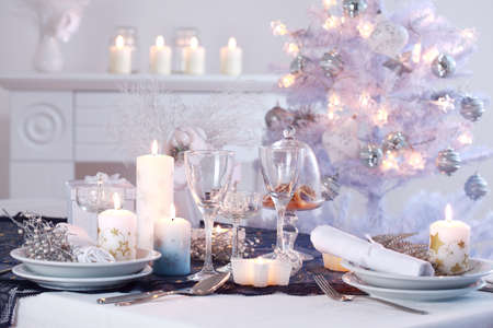 Place setting for Christmas in white with white Christmas tree Stock Photo - 8272752