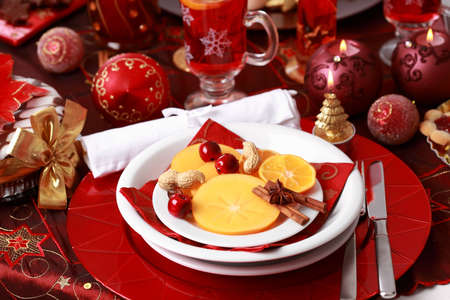Place setting for Christmas with fresh fruits photo