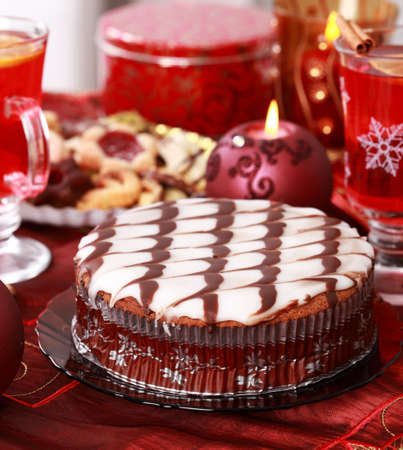 Marchpane cake with wine punch and cookies for Christmas photo