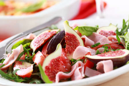 Vegetable salad with  fresh figs photo