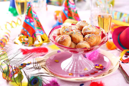 life event: Carnival and party place setting with small berliners (fried doughnut) Stock Photo