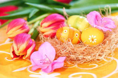 Easter eggs with tulips for spring table decoration photo