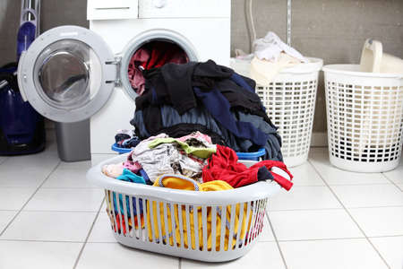 Two baskets of dirty laundry in the washing room photo