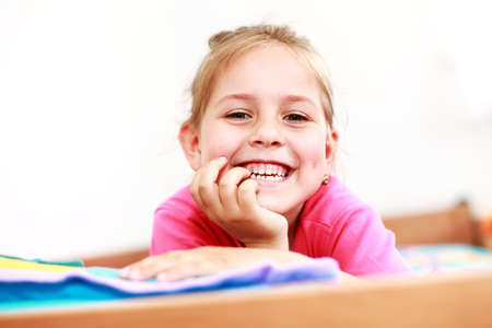 sincerely: Beautiful small girl is smiling  sincerely  Stock Photo