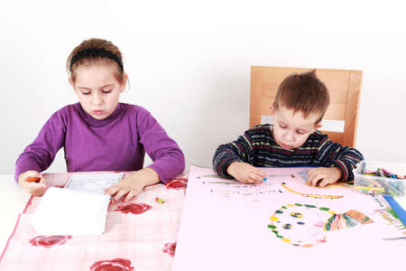 Cute kids drawing and painting photo