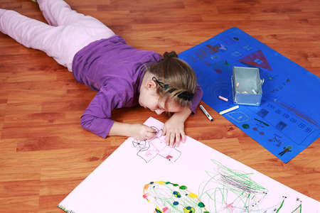 Cute little girl painting on the floor Stock Photo - 8894697
