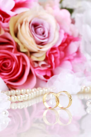 beautiful marriage: Wedding still life with beautiful golden rings and bouquet