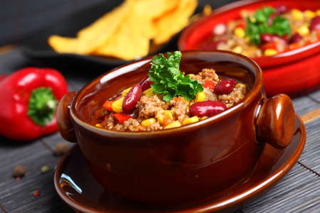 chillies: Bowl of chili with peppers and beans