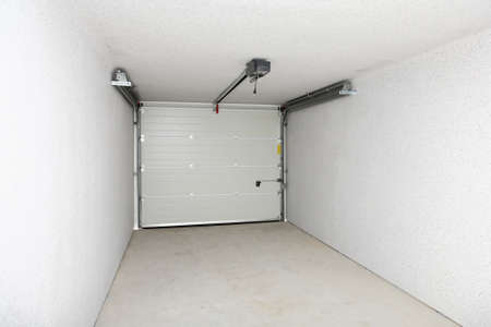 Empty garage or warehouse with closed door photo