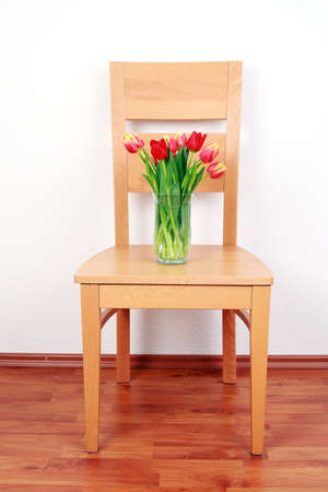 Chair with flowers by the wall Stock Photo - 9044992