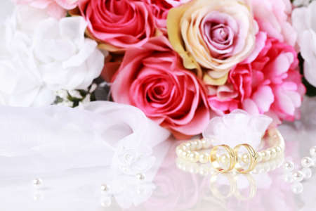 bridegroom: Wedding still life with beautiful golden rings and bouquet