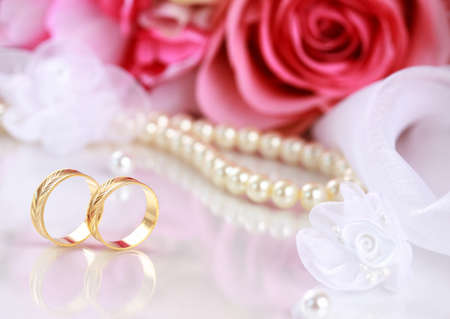 Wedding still life with beautiful golden rings and bouquet photo