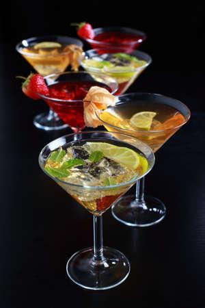 cocktail drinks: Different cocktails or longdrinks garnished with fruits