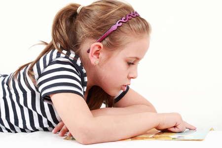 Cute little girl reading a book  photo