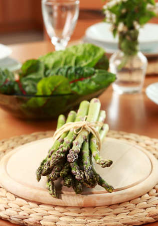 Green asparagus and spinach on the table Stock Photo - 9648583