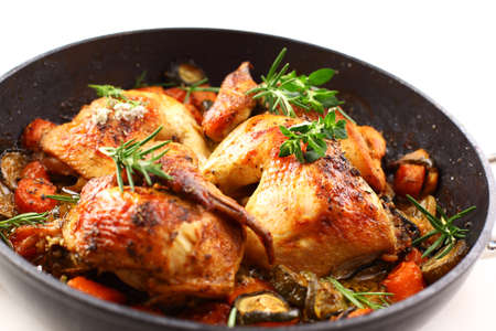 roasting pan: Tasty roasted chicken with vegetable and herbs Stock Photo