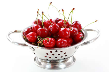 Fresh cherries in the bowl on white background