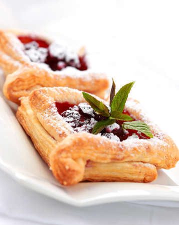 puff: Delicious Cherry puff pastry with powdered sugar