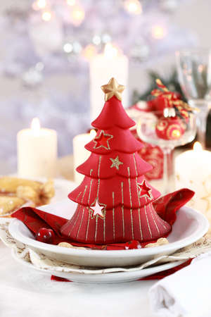 Table setting for Christmas with candle tree photo