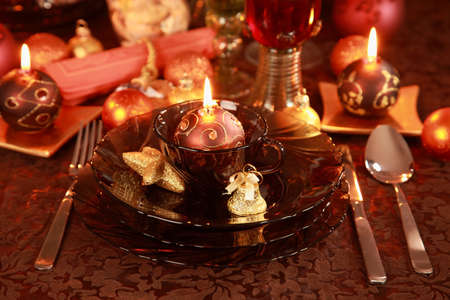 Luxury place setting in golden and brown  for Christmas  photo