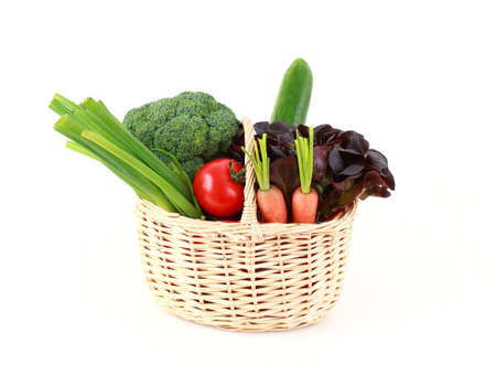 Various vegetables and fruits in the basket on white background photo