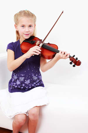 Cute little girl playing violin photo