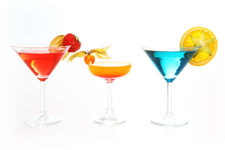 Different cocktails or longdrinks garnished with fruits photo