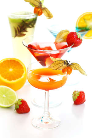 aperitif: Different cocktails or longdrinks garnished with fruits