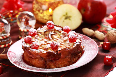 sponge cake: Cake Charlotte for Christmas -  traditional cake with a custard filling, apples and cherry