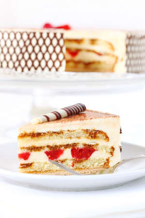 Delicious Tiramisu birthday cake with cherries photo
