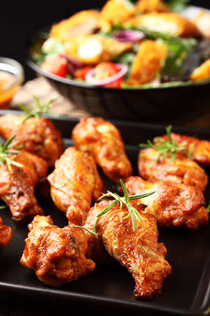 grill chicken: Hot chicken wings on baking tray