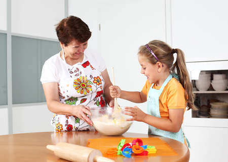 Grandmother and granddaughter baking and having fun together Stock Photo - 10347711