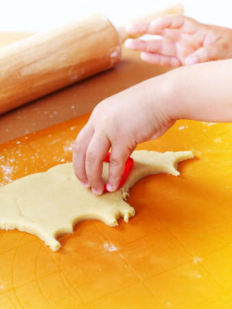 Detail of hands cutting pastry  Stock Photo - 10347709