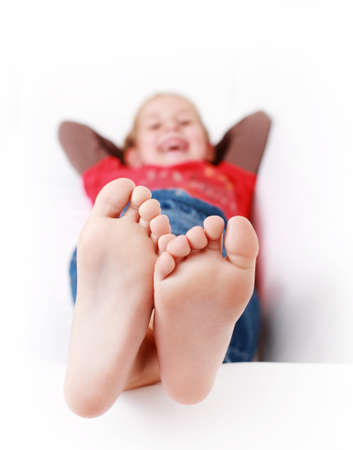 young girl barefoot: Girl relaxing and smiling on the couch
