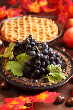 Red grapes and apple pie for Thanksgiving Stock Photo - 10610467