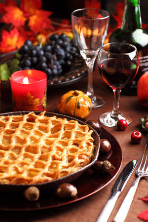 Apple pie for Thanksgiving with wine and grapes photo