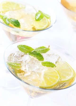 Cocktails or longdrinks garnished with fruits photo
