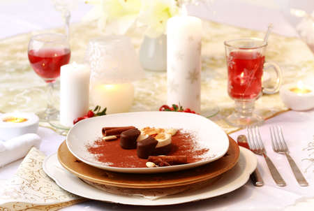 Christmas place setting - dessert with hot wine punch photo