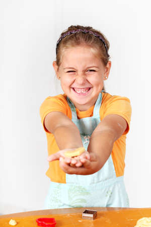 Cute girl baking cookies for Christmas Stock Photo - 10686054