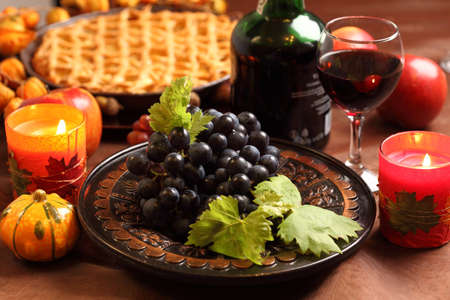Red grapes and apple pie for Thanksgiving photo